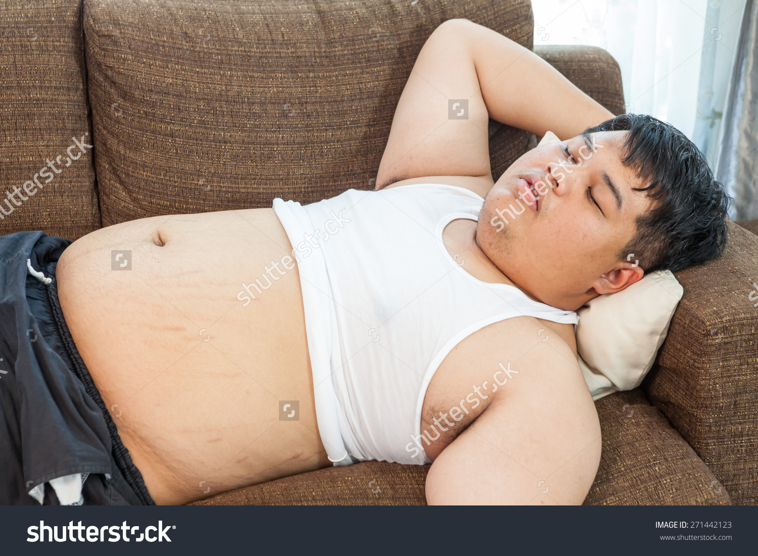 stock-photo-fat-asian-man-sleeping-on-the-couch-271442123.jpg
